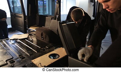 Four men dismantled the car for soundproofing - four men...
