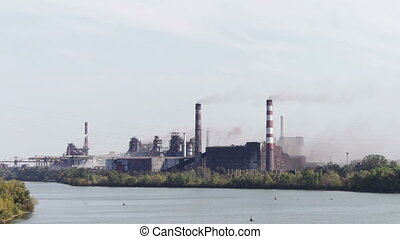 The plant at the river, heavy industry, the smoke from pipes