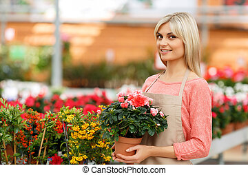 Nice florist working with flowers - Welcome to my world....