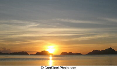 Time lapse of sunset in El Nido village, Philippines -...