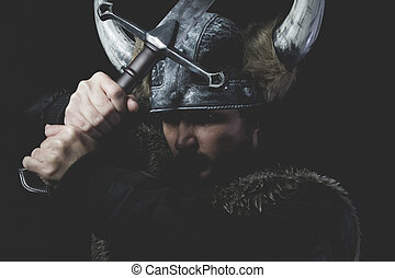 Ancient, Viking warrior with iron sword and helmet with...