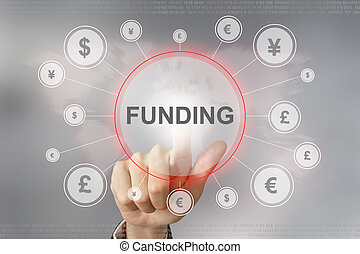 business hand pushing funding button - hand pushing funding...