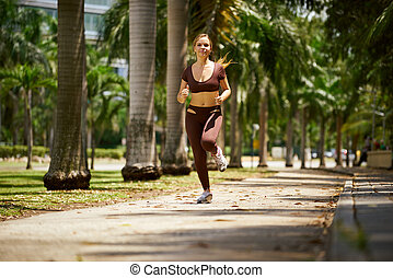 Woman Running At Morning In The City