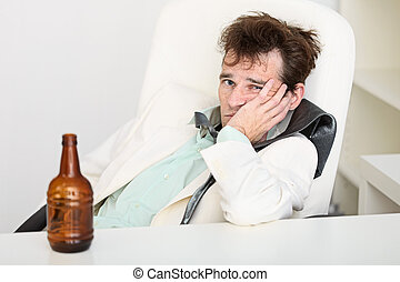 Guy is suffering from hangover because beer is gone - The...