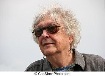 portrait happy smiling lovely elderly woman outside