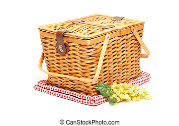 Picnic Basket, Grapes and Folded Blanket Isolated on a White...