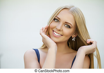 Portrait of attractive young blonde woman - Portrait of...