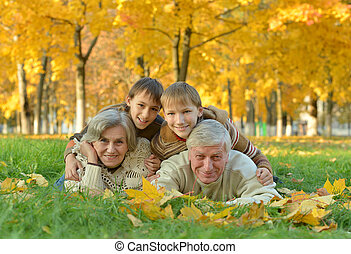 Grandparents and grandchildren in park