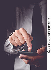 Businessman working on mobile smart phone