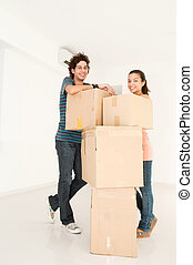 Couple Moving House - A young and attractive couple with...