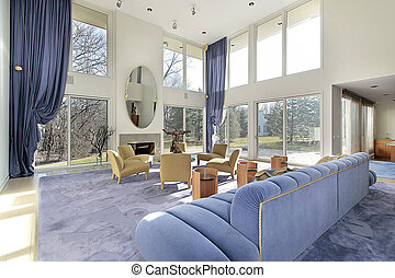 Family room with two story windows