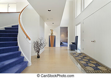 Foyer with spiral staircase - Foyer in luxury home with...