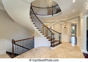 Foyer with curved staircase - Foyer in new construction home...