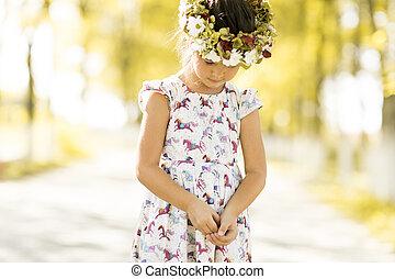 Little girl in the summer park