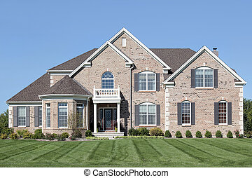 Brick home with small front balcony - Brick home in suburbs...