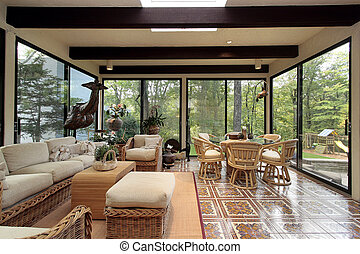 Sunroom with patterned tile - Sunroom in luxury home with...