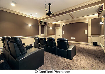 Home theater with stadium seating - Theater in luxury home...