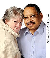 Biracial Senior Couple - Portrait of a loving, biracial,...