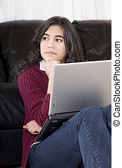 Teen girl with laptop