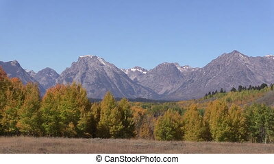 Pan of the Tetons in Fall - pan of the stunning landscape of...