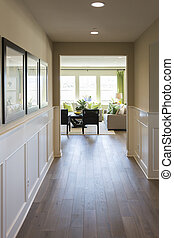 Home Entry Way with Wood Floors and Wainscoting - Beautiful...