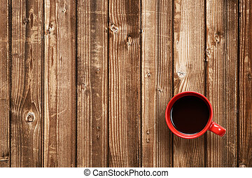 Coffee cup top view on wooden table