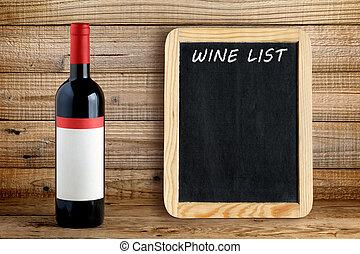 Wine bottle and blackboard for wine list on wooden...