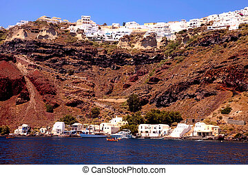 View from the sea of the Oia, Santorini island, Greece -...