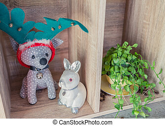 Dog as deer doll with rabit