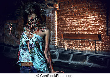 murder - Horrible bloody zombie girl standing outdoor by the...