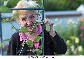 An old woman in his garden