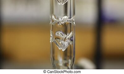 Chemical Distillation - Close-up of a refluxing column for...