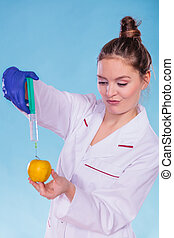 Scientist doctor injecting apple GM Food - Scientist doctor...