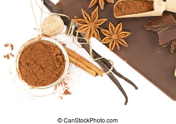 Chocolate and spices on a white background