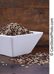 Square bowl of uncooked rice - Square bowl of uncooked red,...