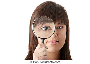 Businesswoman looking into a magniying glass - Young...