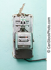The electricity meter on the wall shows the electricity...