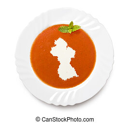 Plate tomato soup with cream in the shape of Guyana.(series)...
