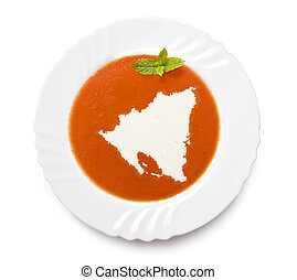 Plate tomato soup with cream in the shape of Nicaraguaseries...