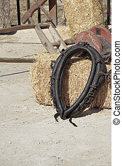 yoke - black leather yoke over a hay bale