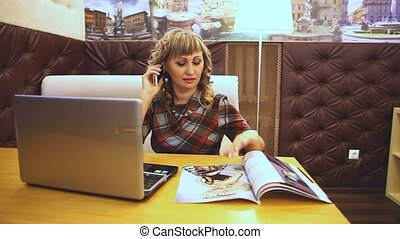 thick fat woman in a cafe reading magazine Journal works for...