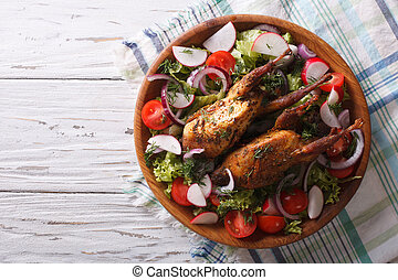 roasted quail and fresh vegetables. horizontaltop view -...