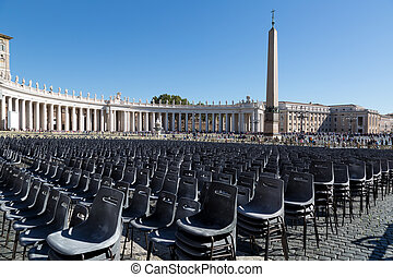Empty chairs behind Cathedral of Saint Peter square  in solar summer day, Vatican