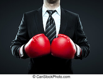 businessman in boxing gloves isolated on gray