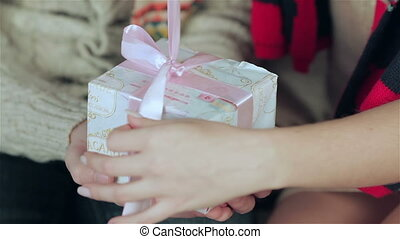 Young handsome guy holding hands while his darling gift...