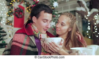 Young couple in love - Loving couple dressed in sweater and...