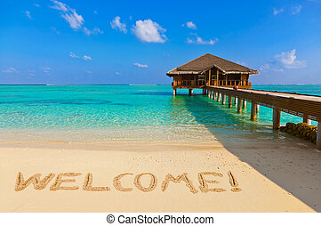 Word Welcome on beach - nature holiday background
