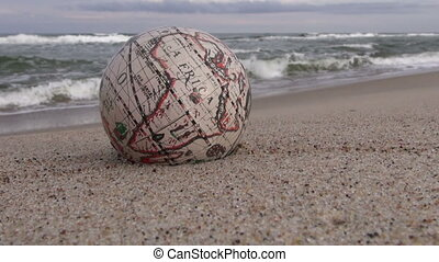 Retro globe on sand by sea - Retro globe with Africa...