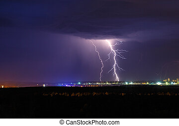 Night thunder lightning over the city sky view