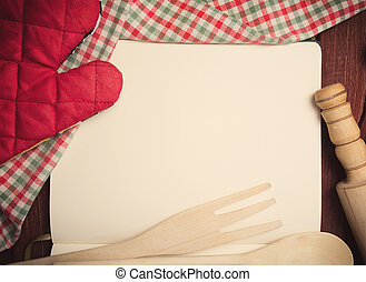 Blank recipe page with napkin and kitchen tools on wooden table